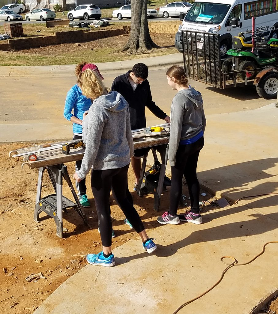 "<b>Wake Forest:</b><br><br>   <div style='font-size:18px;'>""commUNITY is appreciating and learning from each other's skills and passions in order to build something, a goal which Habitat exemplifies in both its final product and its construction process.""  <br><br>  This year, Stamps Scholars at Wake Forest participated in a build with Habitat for Humanity's Forsyth County chapter, working toward's Habitat's mission of building homes, communities and hope.</div>"