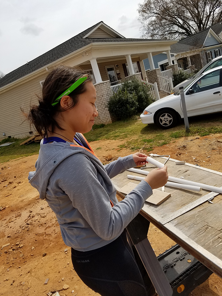 "<b>Wake Forest:</b><br><br>   <div style='font-size:13px;'>""commUNITY is appreciating and learning from each other's skills and passions in order to build something, a goal which Habitat exemplifies in both its final product and its construction process.""  <br><br>  This year, Stamps Scholars at Wake Forest participated in a build with Habitat for Humanity's Forsyth County chapter, working toward's Habitat's mission of building homes, communities and hope. </div>"