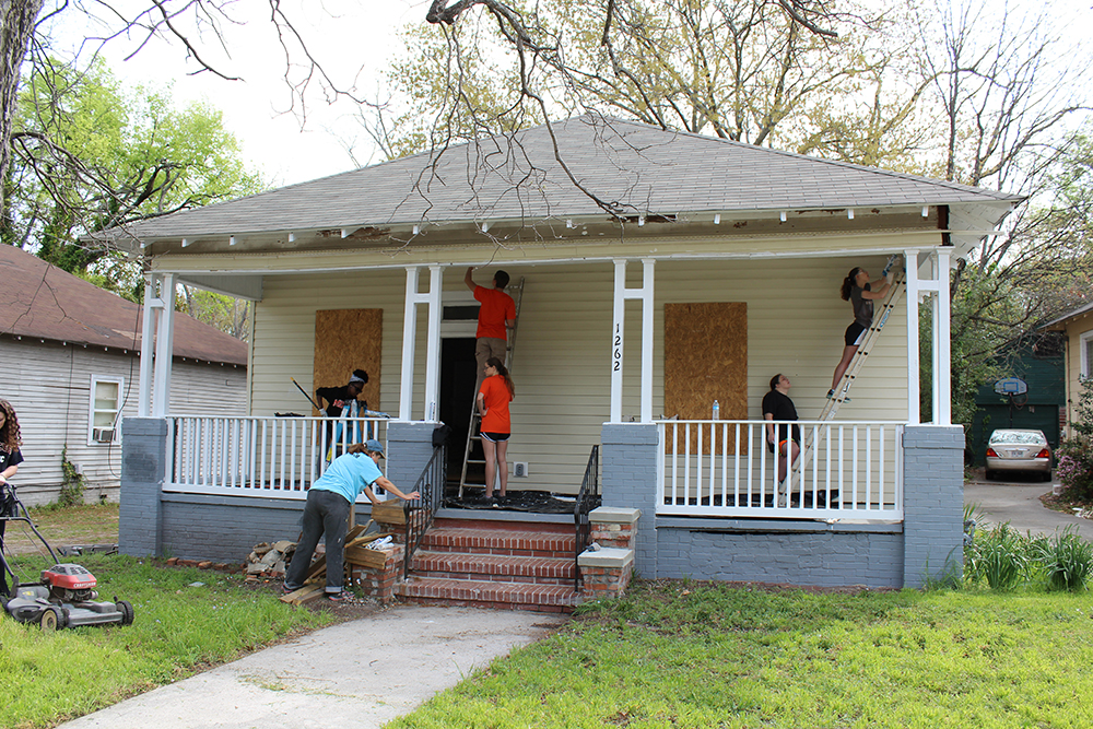 "<b>Mercer University:</b> <br><br>  ""At Mercer, commUNITY means reaching out through research and service for the betterment of both our local and global society."" <br><br>  Mercer Stamps Scholars partnered with the Fuller Center for Housing to address urban blight. The Fuller Center, a non-profit organization founded by the same family who founded Habitat for Humanity, works in Macon to repair, rehabilitate, and resell dilapidated homes to create safe, stable, and equitable communities."