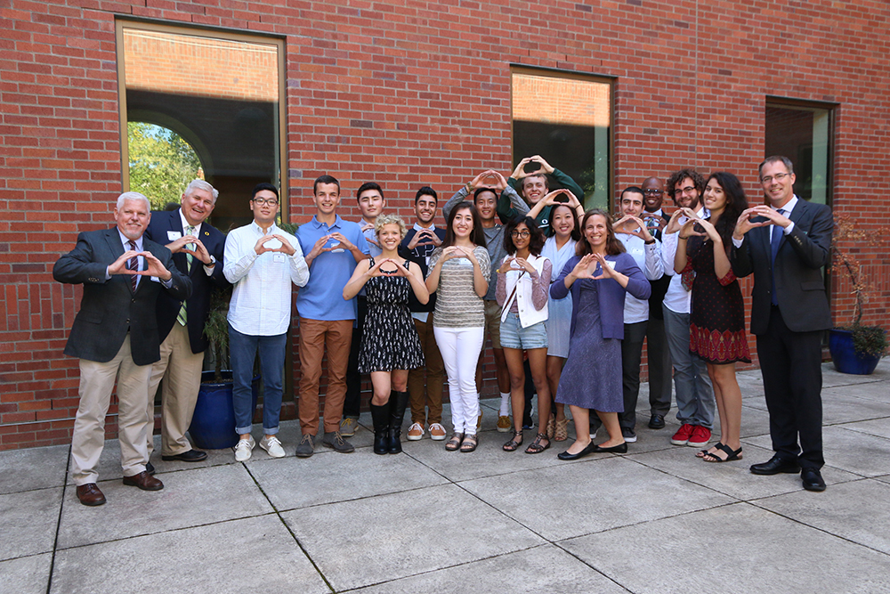 "<b>Univ. of Oregon:</b><br><br>   <div style='font-size:18px;'>""commUNITY means caring for and respecting all members of our society.""  <br><br>  This year University of Oregon Stamps Scholars continued their partnership with St. Vincent de Paul, Lane County's largest nonprofit human services organization. The Scholars helped prepare and serve Sunday breakfast and lunch at the Eugene Service Station.</div>"