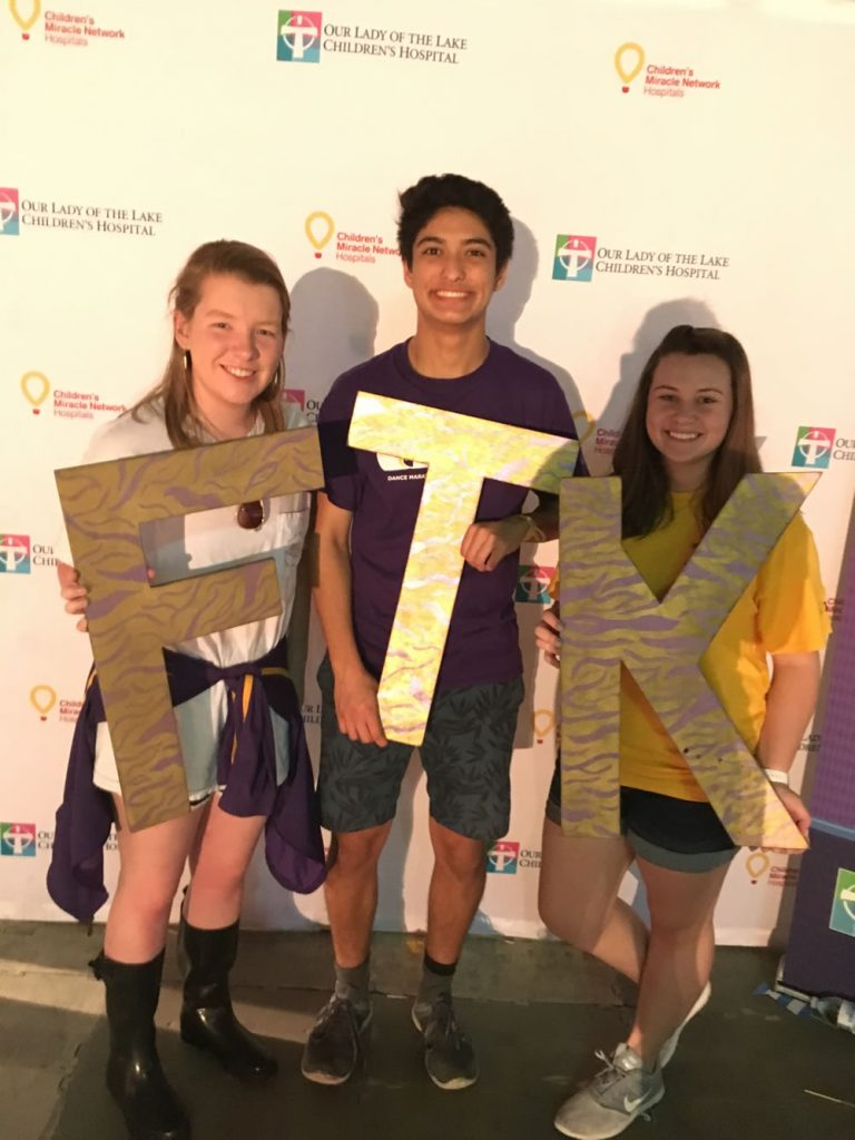 "<b>LSU:</b> <br>  <div style='font-size:8.5px;'>""To the LSU Stamps Scholars, commUNITY means being part of a wider network of society and using our skills and opportunities in order to give back even more than we have been given."" <br><br>  LSU Stamps Scholars participated in two events for the Day of Service. One was through Volunteer LSU's student-run program called Dance Marathon to support Our Lady of the Lake Children's Hospital. Scholars volunteered during the 26-hour dance event, with one Scholar participating in the marathon. The following day, Scholars traveled to Lake Maurepas to volunteer with Coalition to Restore Coastal Louisiana and plant 1000 marsh tree samplings.</div>"