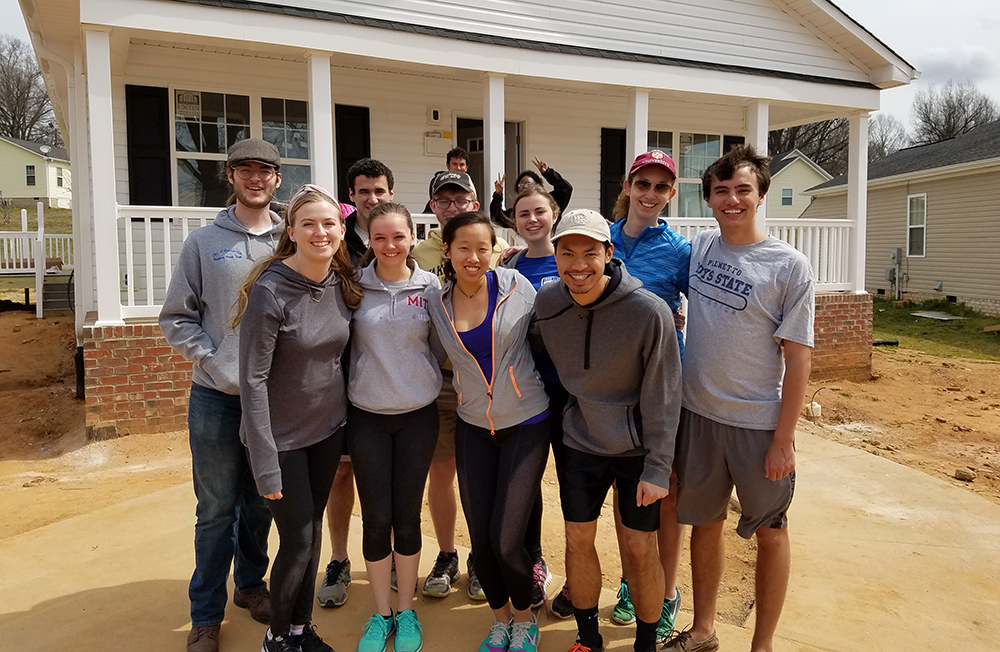 "<b>Wake Forest:</b><br><br>   <div style='font-size:18px;'>""commUNITY is appreciating and learning from each other's skills and passions in order to build something, a goal which Habitat exemplifies in both its final product and its construction process.""  <br><br>  This year, Stamps Scholars at Wake Forest participated in a build with Habitat for Humanity's Forsyth County chapter, working toward's Habitat's mission of building homes, communities and hope. </div>"