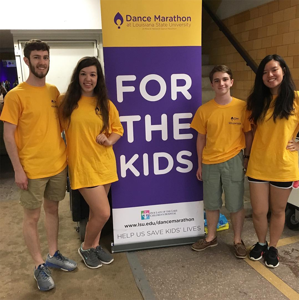 "<b>LSU:</b> <br><br>  <div style='font-size:11px;'>""To the LSU Stamps Scholars, commUNITY means being part of a wider network of society and using our skills and opportunities in order to give back even more than we have been given."" <br><br>  LSU Stamps Scholars participated in two events for the Day of Service. One was through Volunteer LSU's student-run program called Dance Marathon to support Our Lady of the Lake Children's Hospital. Scholars volunteered during the 26-hour dance event, with one Scholar participating in the marathon. The following day, Scholars traveled to Lake Maurepas to volunteer with Coalition to Restore Coastal Louisiana and plant 1000 marsh tree samplings.</div>"