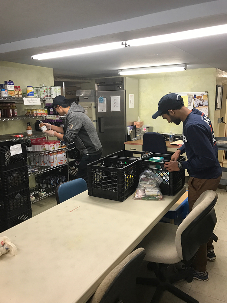 "<b>Univ. of Connecticut:</b><br><br>   <div style='font-size:14px;'>""commUNITY means helping our neighbors.""  <br><br>  For their Day of Service, UConn Stamps Scholars volunteered at the Covenant Soup Kitchen in Willimantic in an effort to support the mission: 'Realizing that people can be impoverished physically, mentally, emotionally, spiritually, socially and financially, Covenant Soup Kitchen provides food and access to basic services in an environment of care, love, support and safety to those individuals and families from the greater Windham community who come through our doors.' So, on March 25th, the UConn Stamps Scholars helped the soup kitchen stock shelves in their food pantry, organize paperwork, pack bag lunches, prepare food trays, wash dishes, and do clean-up.</div>"